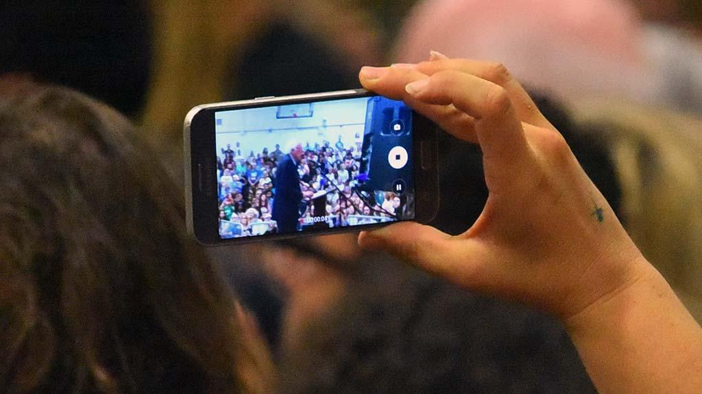 Supporters record Sen. Bernie Sanders' speech in the MiraCosta gym in Oceanside.