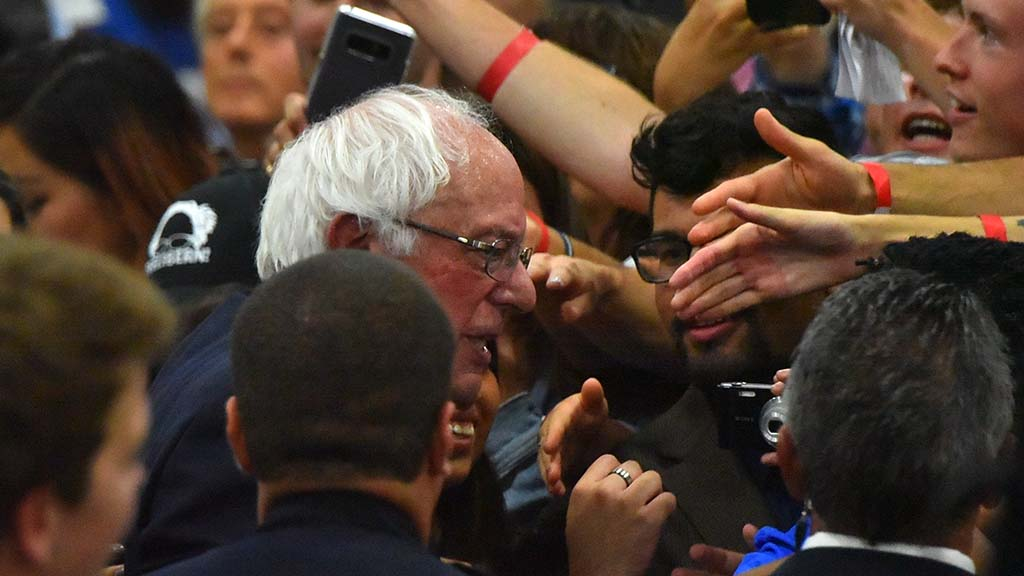 Sen. Bernie Sanders shakes hands with supporters at the end of the rally.