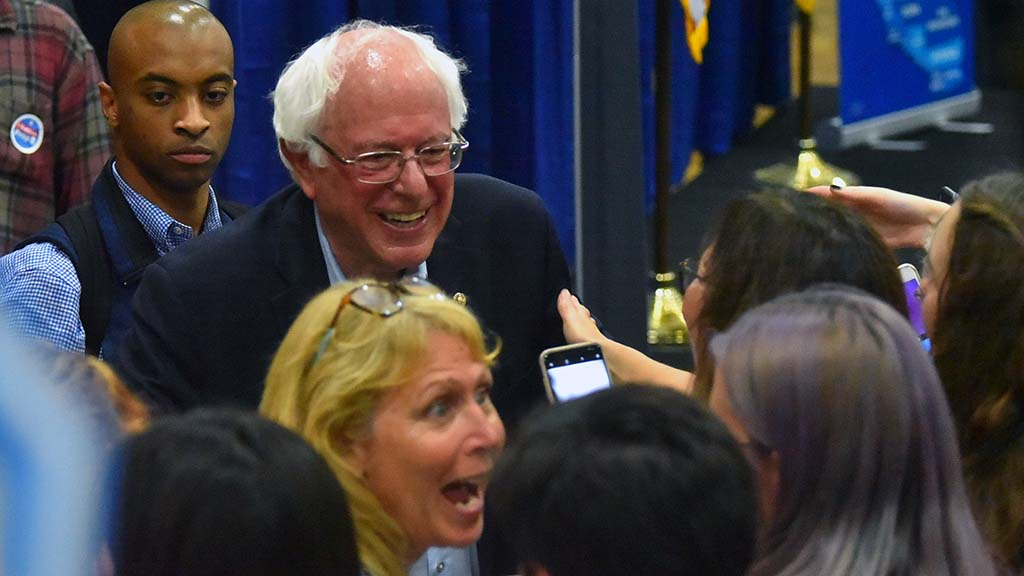 A supporter seems excited to meet Sen. Bernie Sanders at a rally in Oceanside.
