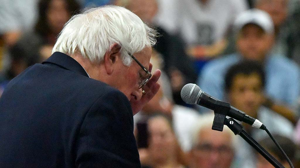 Sen. Bernie Sanders wipes perspiration from his forehead during a get-out-the-vote rally in a warm gym at Mira Costa College in Oceanside.