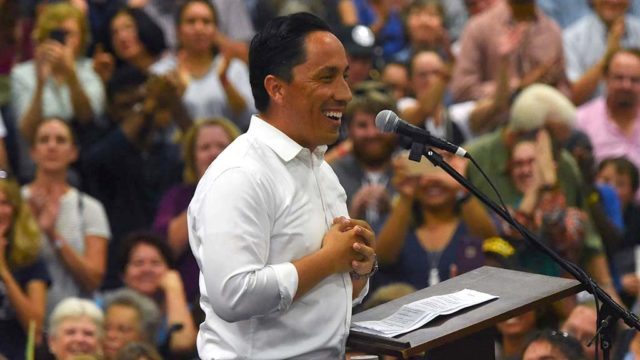 Assemblyman Todd Gloria acknowledges the crowd at the MiraCosta College gym in Oceanside.