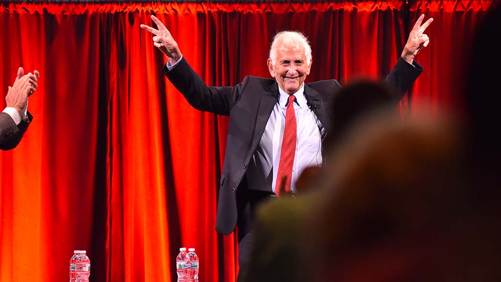 Daniel Ellsberg flashed victory signs upon his arrival on stage (to a standing ovation).