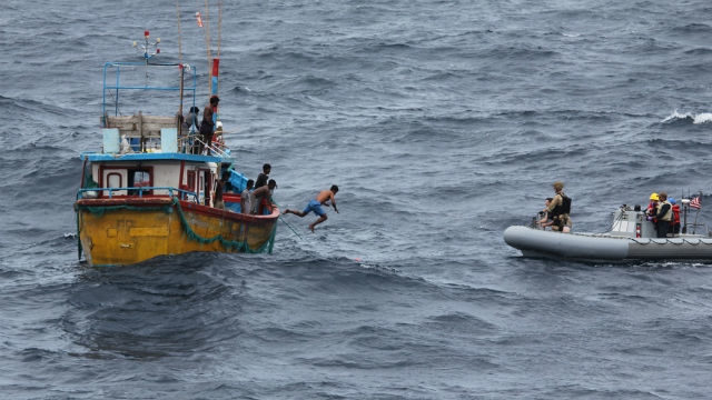 Navy team approaches the stranded fishing boat