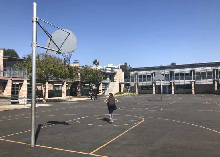 Students walk across the basketball courts at Grant Elementary School in the San Diego Unified School District on Sept. 20, 2018. (Megan Burks/KPBS)