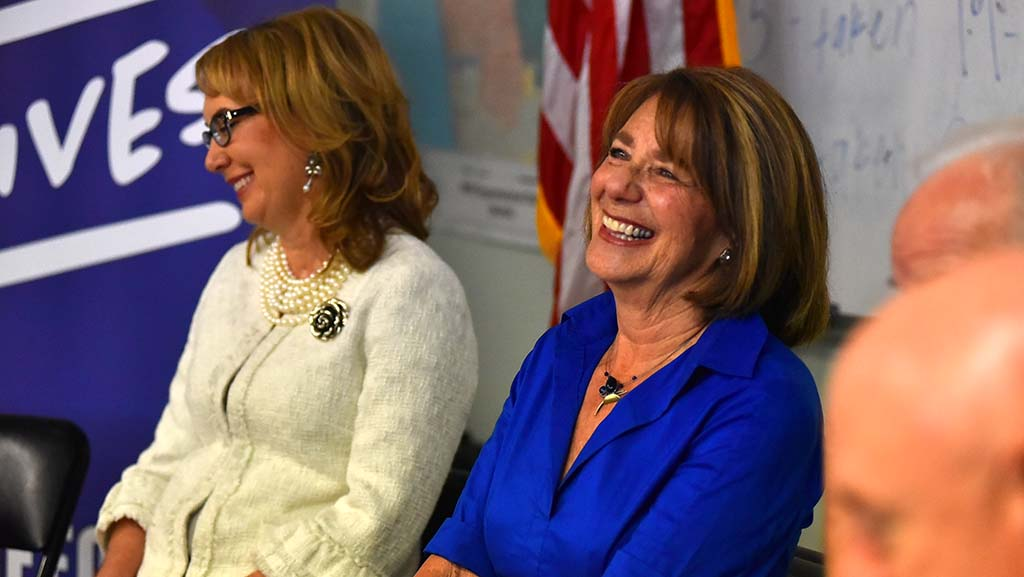 Former Rep. Gabriel Giffords and Rep. Susan Davis share a laugh in Solano Beach at Congressional candidate Mike Levin's headquarters.