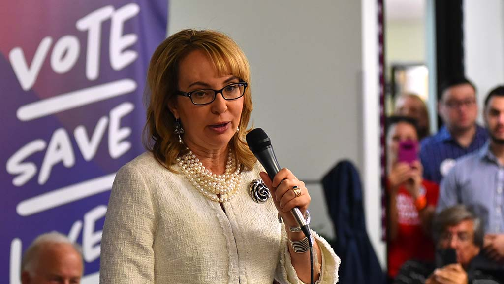 Former Rep. Gabby Giffords, speaking last, gives group a pep talk before Mike Levin offers canvassing training.