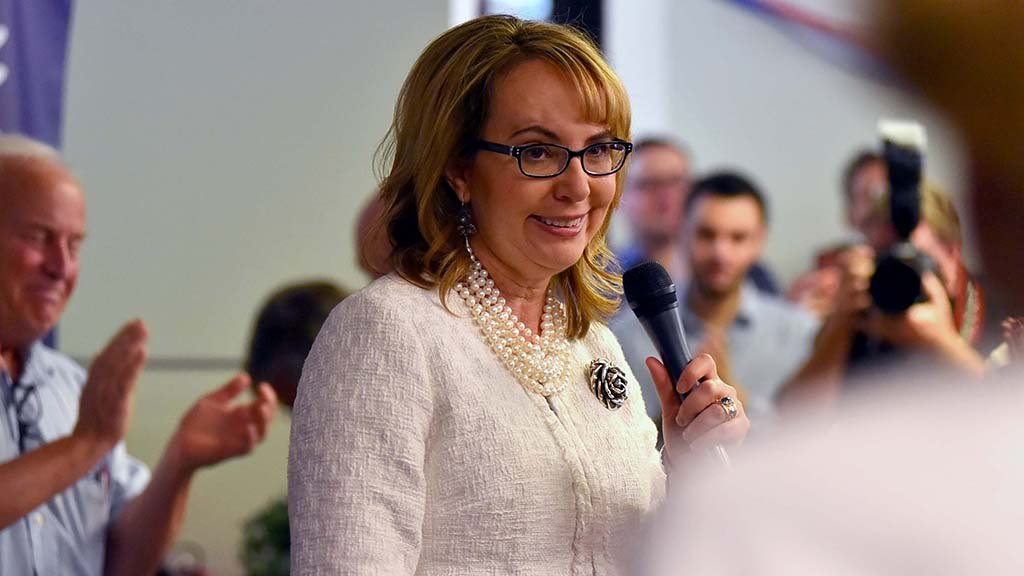 Former Rep. Gabriel Giffords acknowledges applause before she speaks.