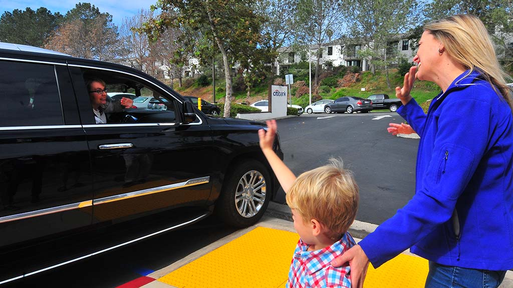 Mike Levin's wife, Chrissy, and son, Jonathon, wave goodbye to former Rep. Gabriel Giffords.