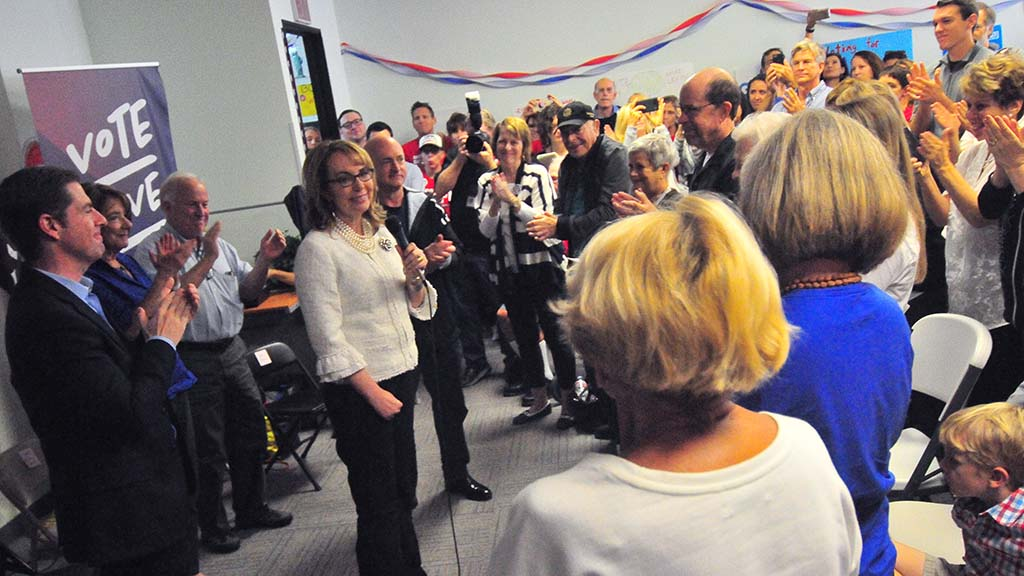 Former Rep. Gabriel Giffords is welcomed by a room filled with supporters.