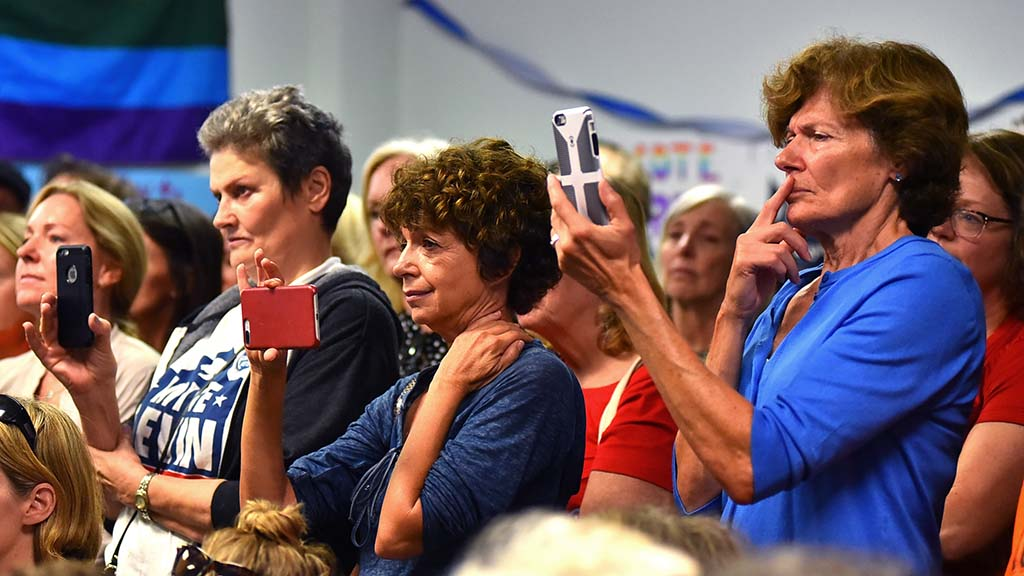 Audience members takes video of former Rep. Gabriel Giffords talk in Solana Beach headquarters of Mike Levin.