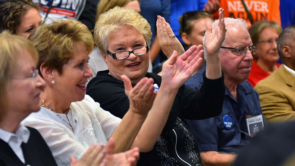Audience members react to a comment at Congressional candidate Mike Levin's headquarters in Solano Beach.