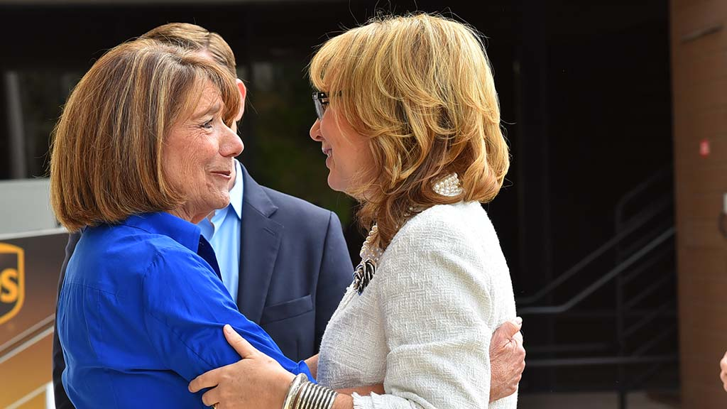 Rep. Susan Davis (left) and former Rep. Gabriel Giffords embrace before the event.