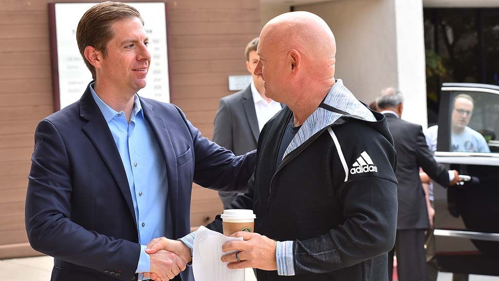 49th Congressional district candidate Mike Levin greets retired astronaut Mark Kelly in Solano Beach.