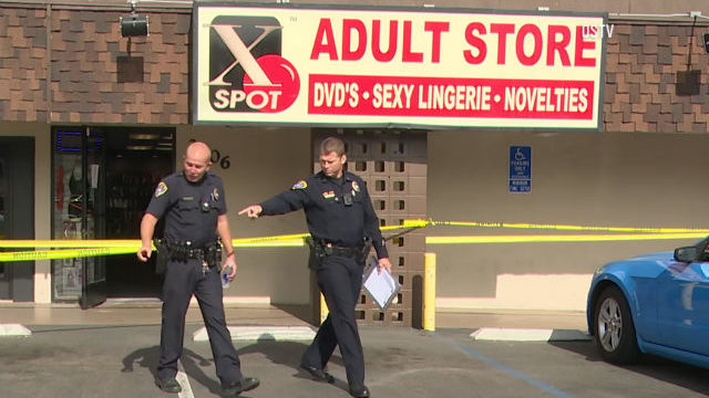 Police officers outside sex shop