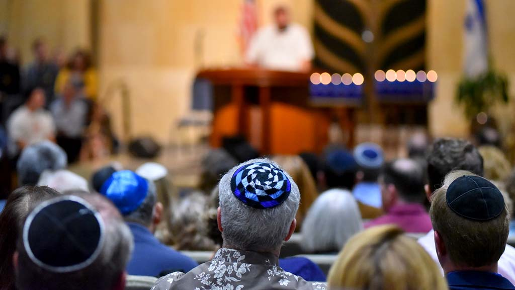 Yarmulkes were as diverse as those attending the Beth Israel community vigil.