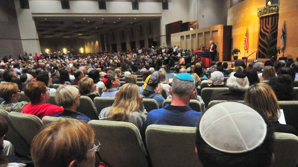 As many as 1,300 — including many standing indoors — took part in the vigil at Beth Israel.