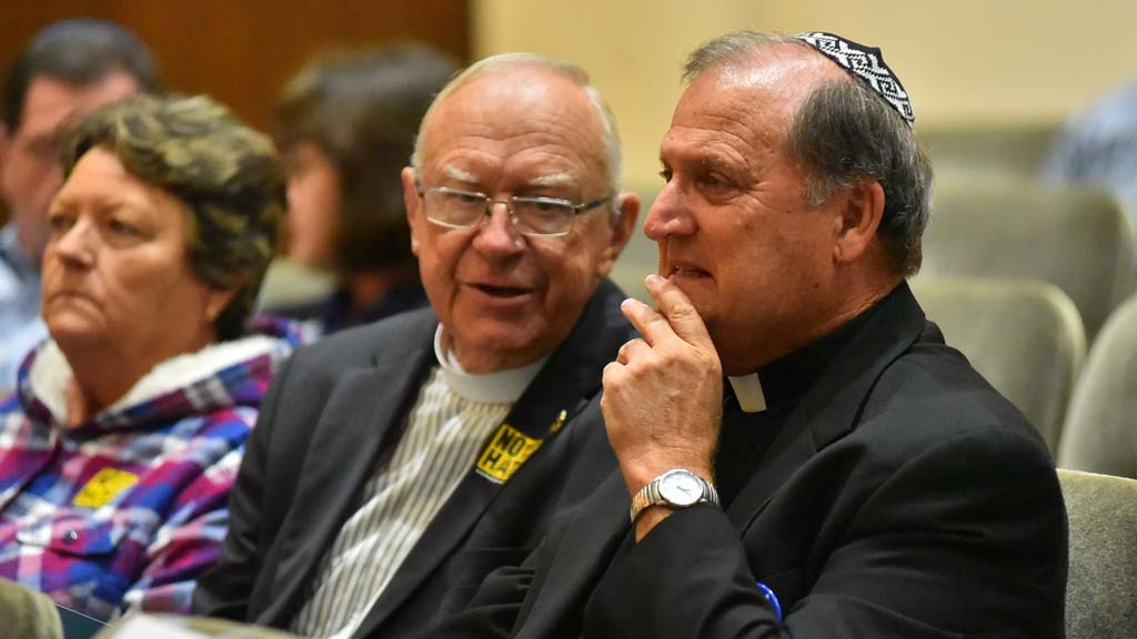 A priest wore a yarmulke, or skullcap, in honor of the Jewish victims in Pittsburgh.