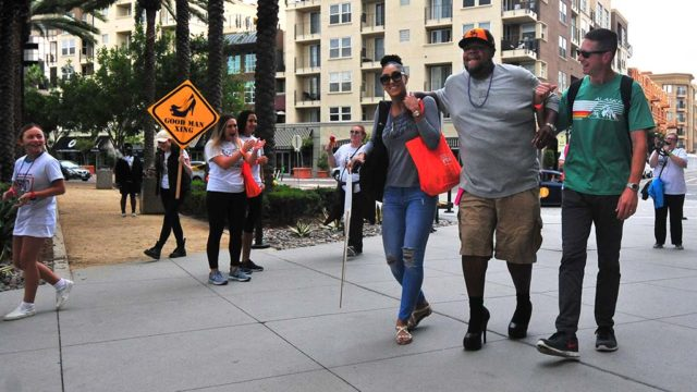 Dennis Ellis got some assist as he finished his eighth walk for the Walk a Mile in Her Shoes YWCA fundraiser.