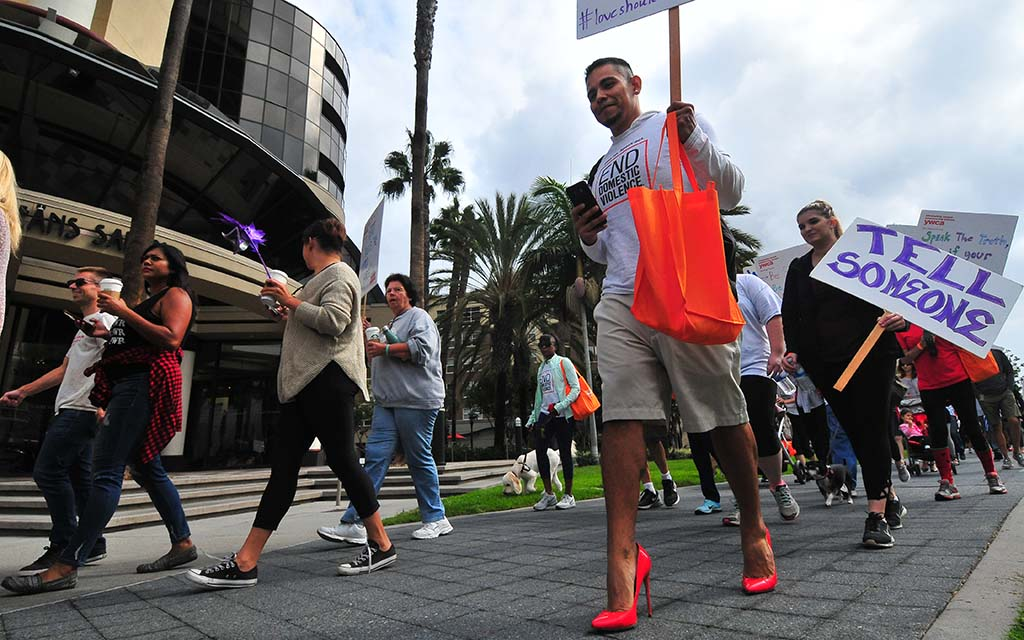 Some men rose to new heights as they donned high heels for the one-mile walk downtown.