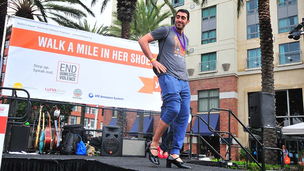 Moe Hamidi of San Marcos shows off his fashion sense in a contest before the walk.