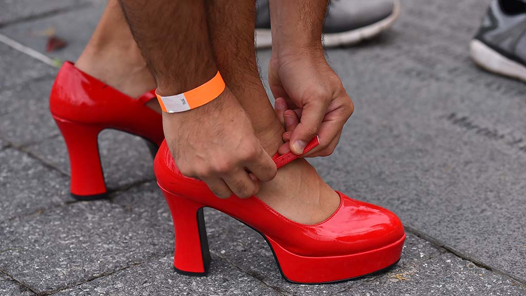 Dan Asbaty of Del Mar tries on a pair of women's shoes for a good cause.