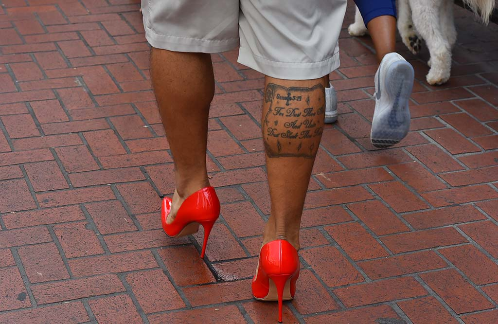 Men, women and dogs were among the participants in the mile walk downtown.