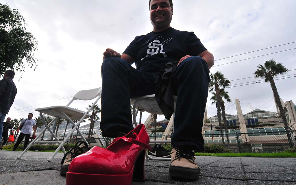 """About two dozen men braved blisters and twisted ankles to wear women's heels in the """"Walk a Mile in Her Shoes."""""""