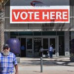Voters enter and exit San Diego County Registrar of Voters Office in Kearny Mesa.