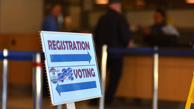 Sign at San Diego County Registrar of Voters Office in Kearny Mesa directs customers.