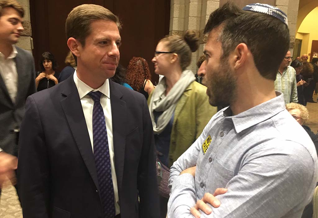 Mike Levin, the Democratic candidate in the 49th Congressional District, chats before the vigil.