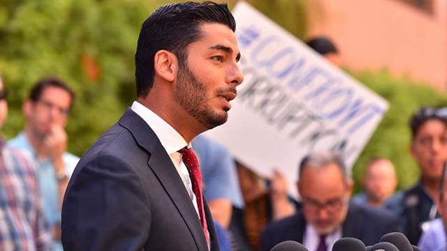 Ammar Campa-Najjar speaks to the media and protesters outside the federal courthouse after Duncan Hunter arraignment in August.