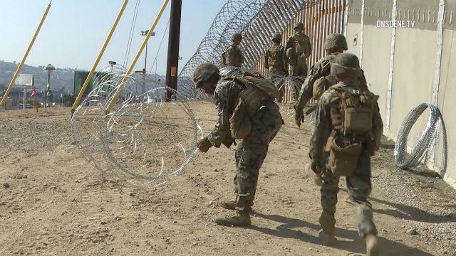 Marines set up concertina wire