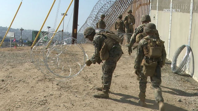 Marines set up concertina wire