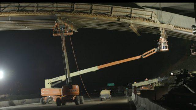 Caltrans crews remove wooden support beams