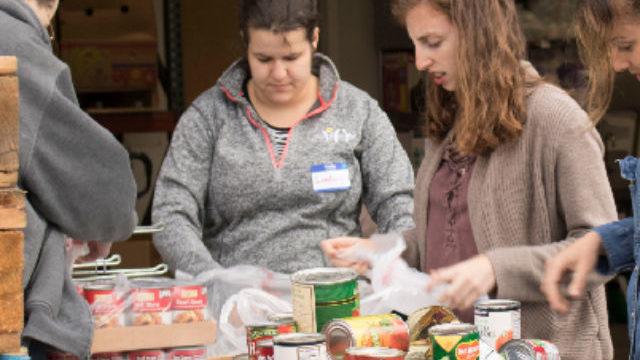 Volunteers hand out food at a Hand Up Food Pantry event