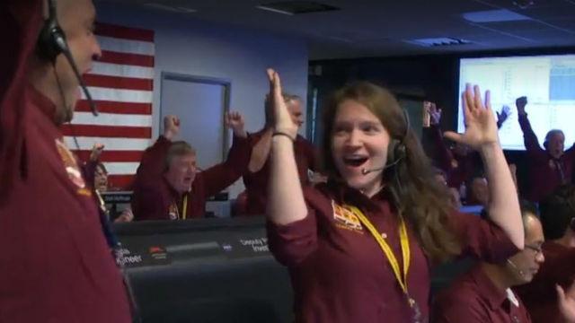 JPG staff cheer the safe landing