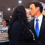 Lorena and Nathan Fletcher share a celebratory kiss in Golden Hall.