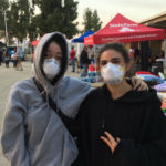 Women wearing masks because of smoke from the Woolsey Fire