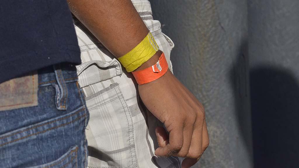 Wristbands were seen on migrants throughout Tijuana.