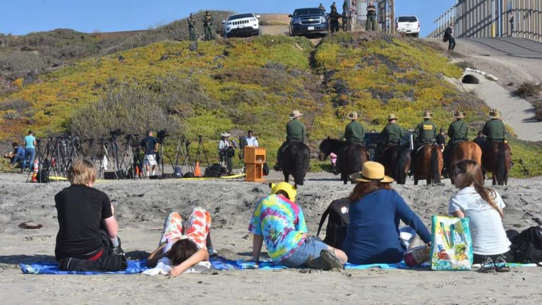 Visitors to Border Field State Park have a picnic on the beach before Kirtsjen Nielsen press conference.