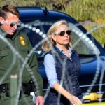 Homeland Security Secretary Kirstjen Nielsen walks past concertina wire on her way to view the border fence.