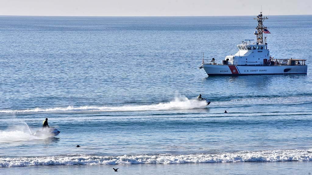 The U.S. Coast Guard patrolled the shore during the press conference by Homeland Security Secretary Kirsten Nielsen.