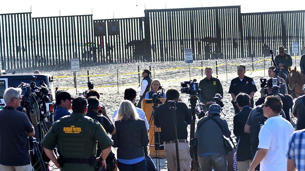 National and local media attended a press conference with Homeland Security Secretary Kirsten Nielsen , who repeated the president's opinions.