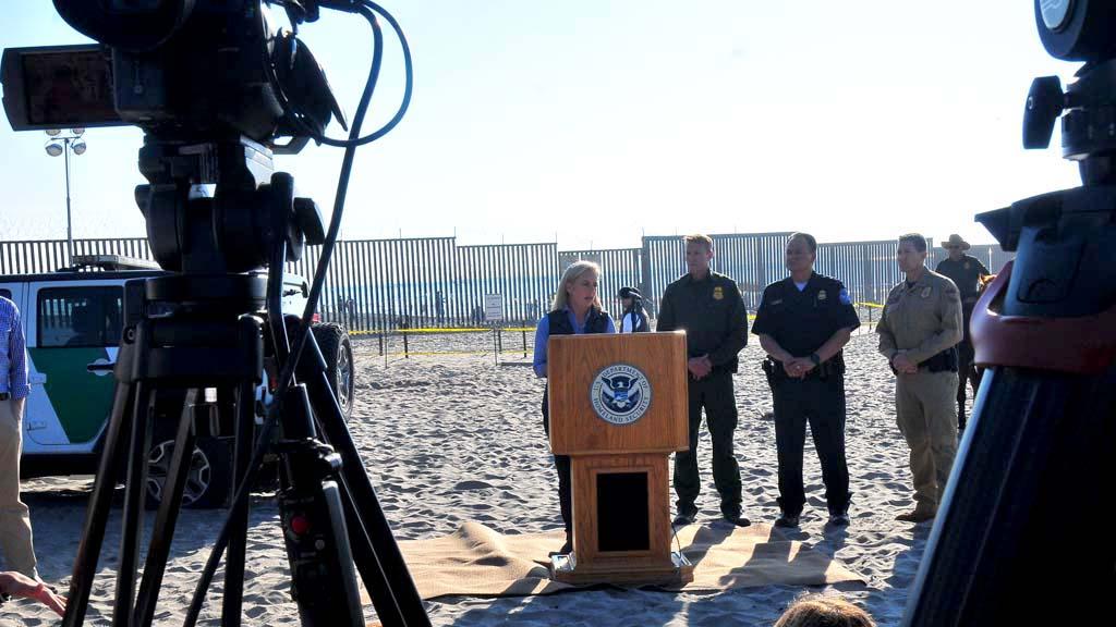 Homeland Security Secretary Kirsten Nielsen speaks to the media yards from the border fence.