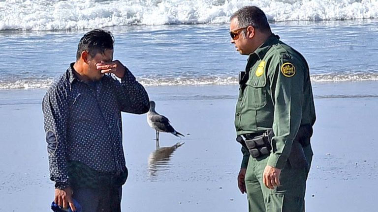 A man who said he was from Nicaragua appears to cry as he talks to a Border Patrol supervisor.