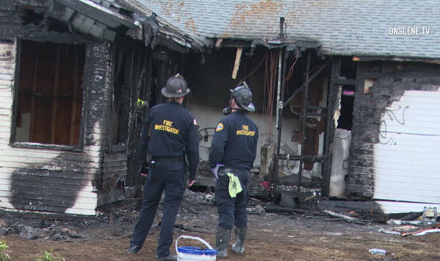 San Dire Fire-Rescue personnel examine fire damager