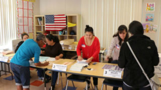 Poll workers at a school