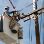 SDG&E crew working on a power pole