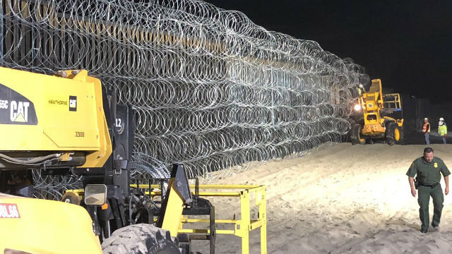 Concertina wire along the border fence in San Diego