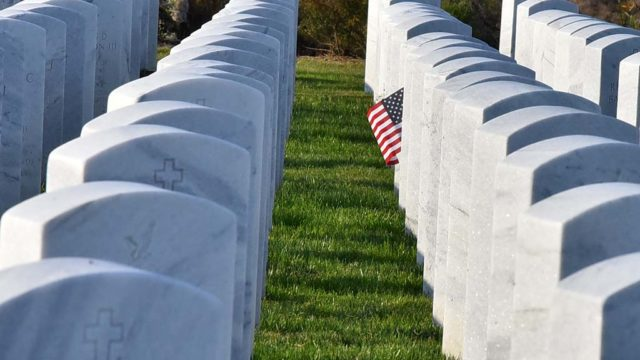 Flowers and flags were left at grave sites at Miramar National Cemetery on Veterans Day.